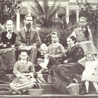 Old black and white photograph of a family