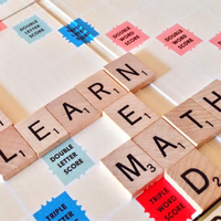 Words on a scrabble board - learn, read, write