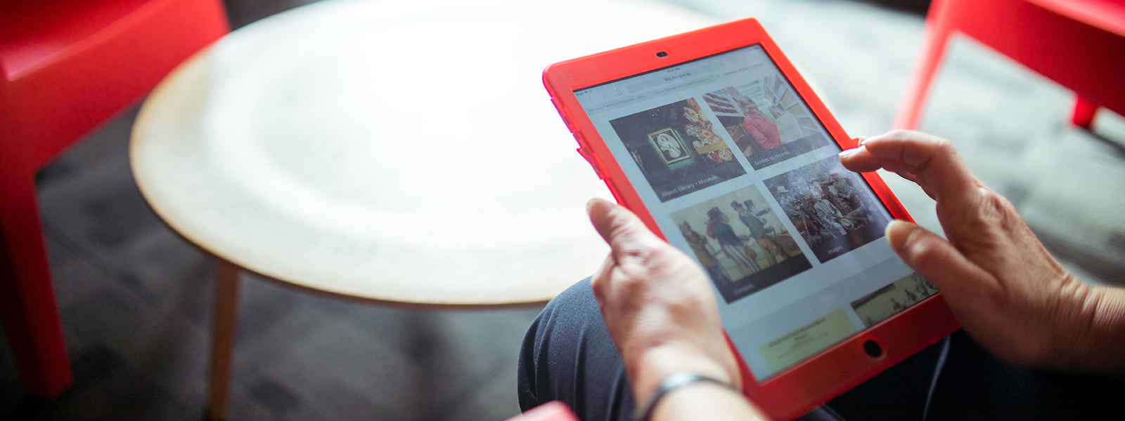 Image of person using a device to find eLibrary